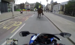 Superbike rider is caught by a policeman on a horse