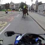 Superbike rider is caught by a policeman on ahorse
