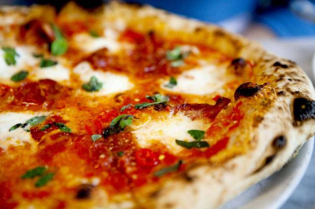 Close up of delicious cheese pizza on plate Tina Wong/Tina Wong